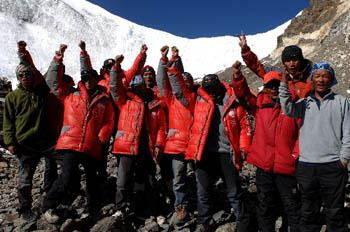 Chinese Mountaineering Team members and mountaineering training school members pose for a photo after they successfully pave the ascent route above the altitude of 8300 meters to Mount Qomolangma on May 7, 2008. (Photo credit: Suolang Luobu/Xinhua)